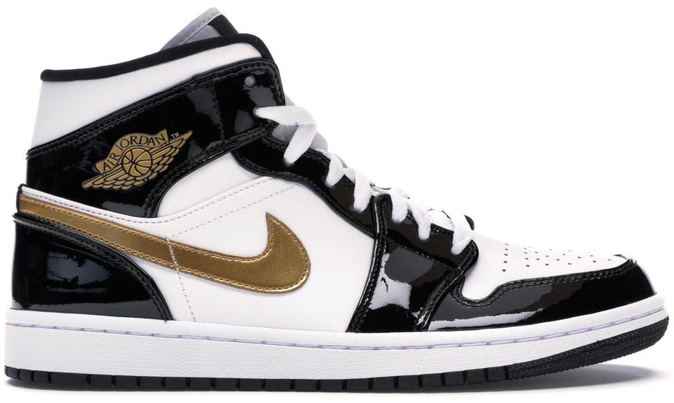 black and gold low top jordans